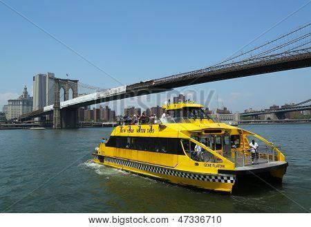 New York City Water Taxi under Brooklyn Bridge