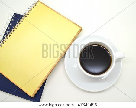 notebooks and a cup of coffee