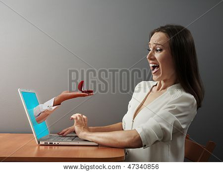 shocked woman looking at wedding ring
