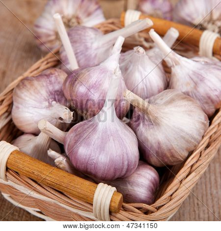 Garlic In The Basket On The Table