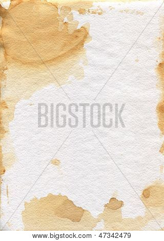 Old shabby paper. Granular texture of the paper.Tea stains.