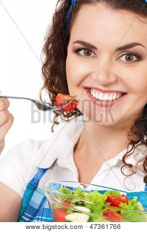 Beautiful girl eating healthy food on white background