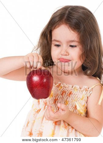 Portrait of little girl with apple, isolated on white background