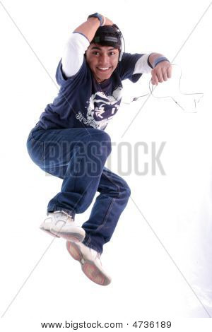 Young Man Jumping With Music Player On White Background