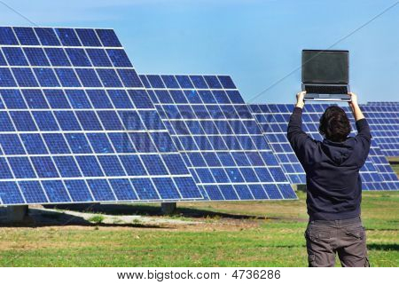 Young Man In Central Of Photovoltaic.