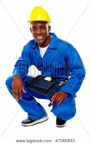 Seated African Worker Posing With A Smile