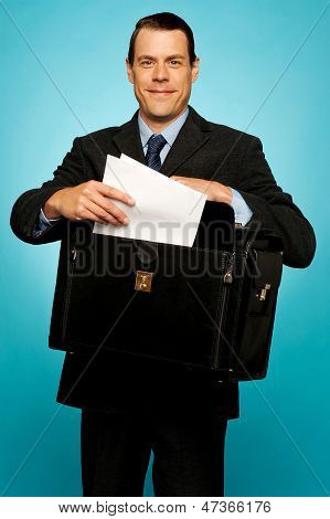 Male Executive Arranging Paper Works