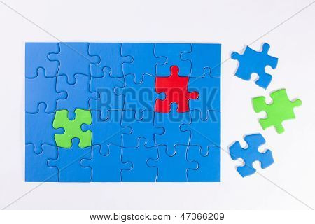 Jigsaw Puzzle With Colored Pieces Signifying Diversity And Equality