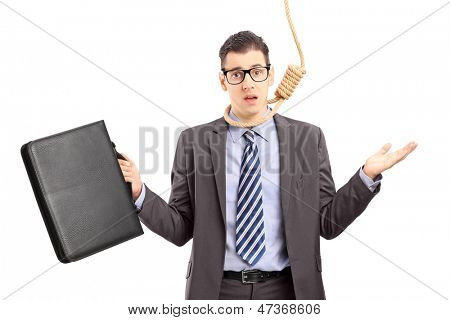 Depressed young businessman in suit executing a suicide with a rope, isolated on white background