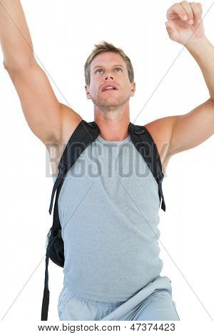 Man doing his exercices on white background