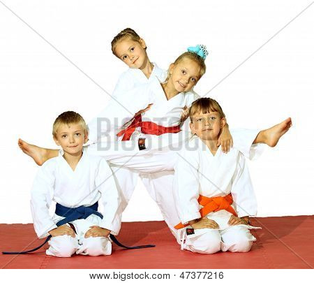 Four athletes in a kimono on a white background