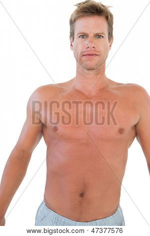 Shirtless man gesturing in front of the camera on white background