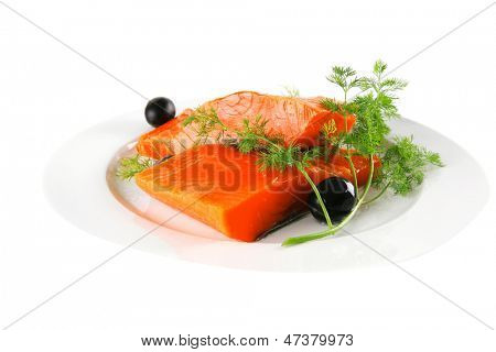 single pink salmon bit on a big white dish