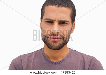 Handsome man frowning on white background