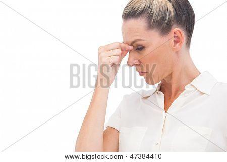 Businesswoman pinching nose because of headache