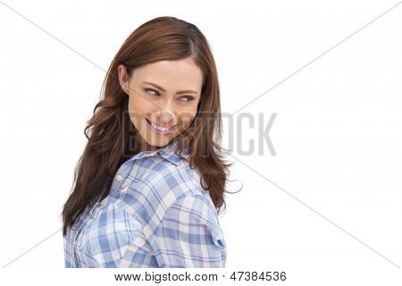 Smiling woman looking something behind her on white background