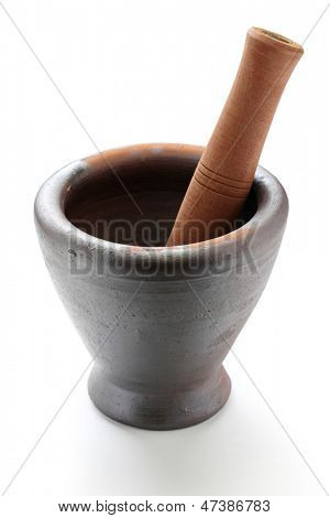 thai traditional clay mortar and wooden pestle for som tam