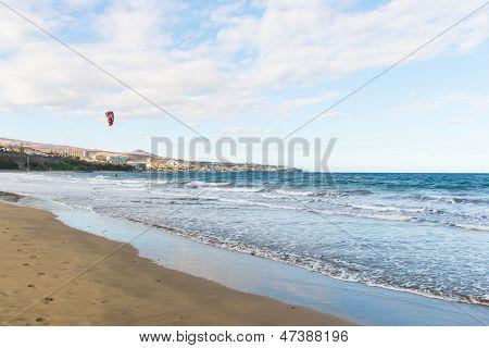 Parachutist Riding The Waves