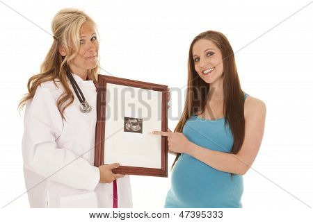 Pregnant Woman Doctor And Ultrasound Pointing