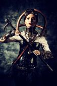 stock photo of steampunk  - Portrait of a beautiful steampunk woman over grunge background - JPG