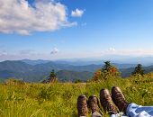 stock photo of blue spruce  - Hikers enjoying the view on Round Bald Roan Mountain State Park North Carolina