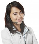 stock photo of filipina  - A young woman wearing a headset  - JPG