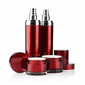 picture of spray can  - Red cosmetic cans of moisturizer isolated on white