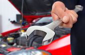 stock photo of auto garage  - Hand with wrench - JPG