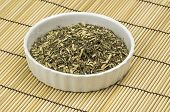 image of catnip  - A heap of dired catmint in a White bowl - JPG