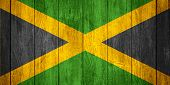 picture of jamaican  - flag of Jamaica or Jamaican banner on wooden background - JPG