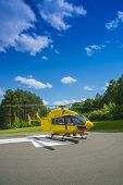 image of medevac  - Paramedics helicopter prepared to uploading patient with dors open - JPG