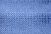 picture of aida  - Closeup image of woven blue aida cloth used for cross stitch - JPG