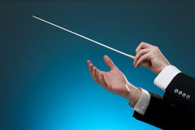 stock photo of nonverbal  - Male orchestra conductor hands one with baton - JPG