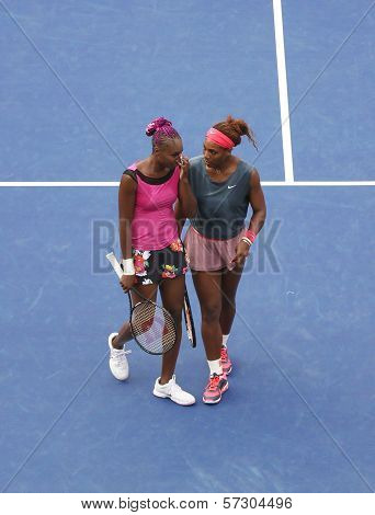 Grand Slam champions Serena and Venus Williams during second round doubles match at US Open 2013