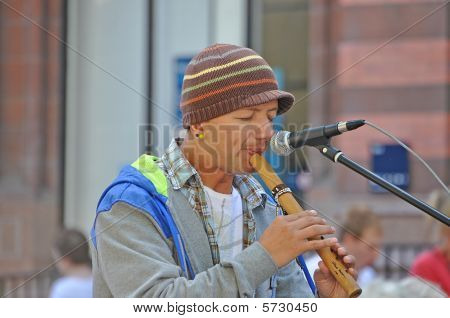 York, England - 14 August - Peruvian Busker Playing A Recorder Type Instrument In York City Centre T