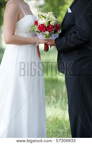 Bride And Groom And Bouquet