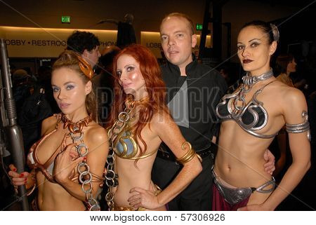 Paula Labaredas, Phoebe Price, Jamin Fite and Annisse annual Slave Leia Group Photo at ComicCon, San Diego Convention Center, San Diego, CA. 07-23-10