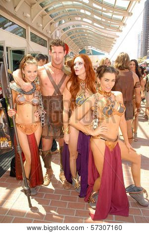 Paula Labaredas, Phoebe Price and Alicia Arden at the annual Slave Leia Group Photo at ComicCon, San Diego Convention Center, San Diego, CA. 07-23-10