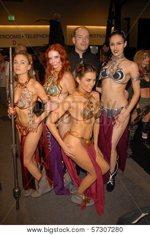 Paula Labaredas, Phoebe Price, Jamin Fite, Alicia Arden and Annisse at the annual Slave Leia Group Photo at ComicCon, San Diego Convention Center, San Diego, CA. 07-23-10