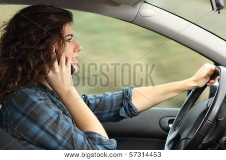 Side View Of A Woman Driving A Car And Talking On The Phone