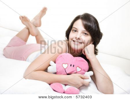 Teenager on bed with toy