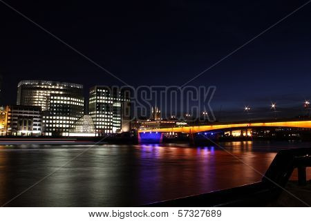 London nightscape and coloured bridge