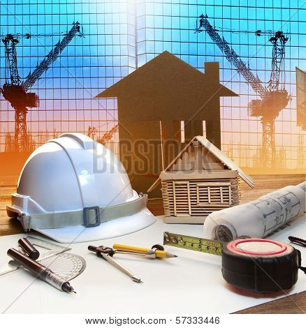Office Tower And Home Construction Plan On Architect Working Table With Modern Building And Crane Ba