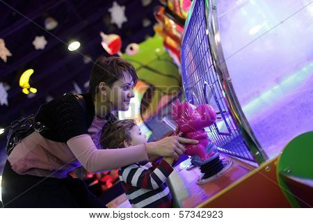 Family Playing In Amusement