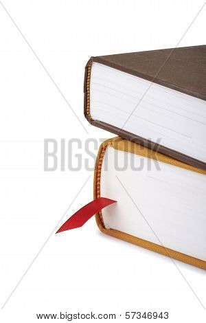 Pile Of Books With A Red Bookmark