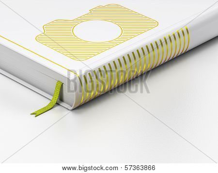 Tourism concept: closed book, Photo Camera on white background