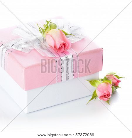 Gift Box With A Silver Bow And Roses