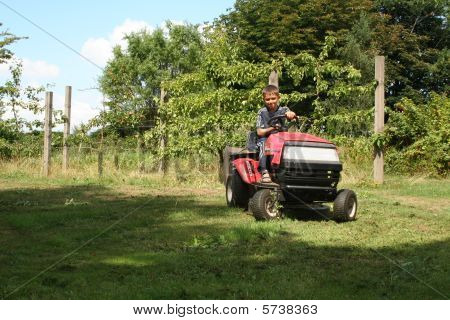 Garden Tractor Child Mowing Grass