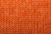 stock photo of knitwear  - Macro detail of orange knitted wool texture or background - JPG
