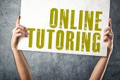 foto of tutor  - Man holding banner with ONLINE TUTORING title conceptual image - JPG